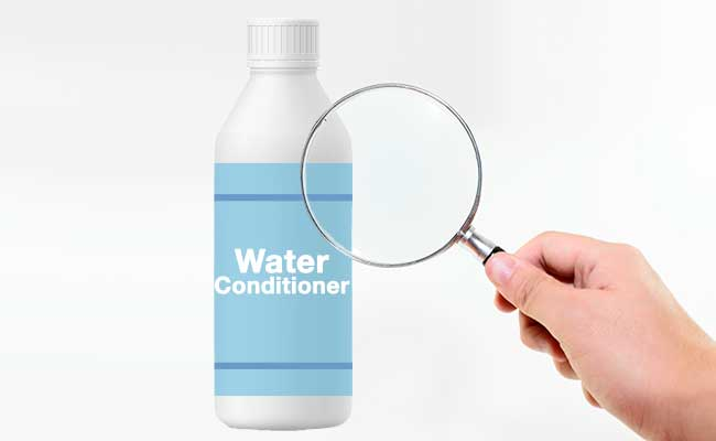 Bottle of water conditioner viewed under magnifying glass