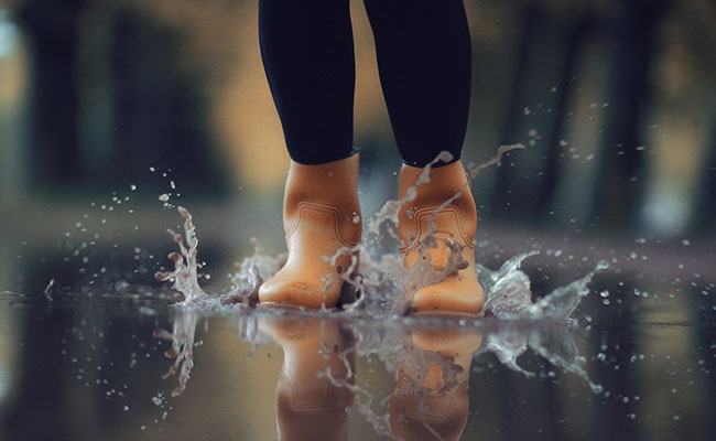 Jumping in puddle of water to agitate the surface