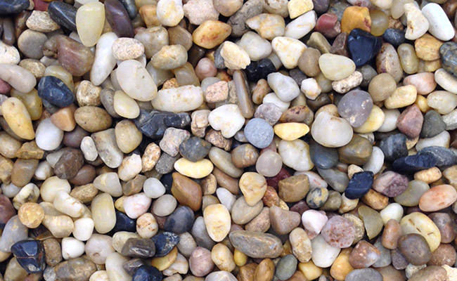 Assorted smooth gravel used as an aquarium substrate