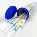 A tube of 5-in-1 aquarium test strips