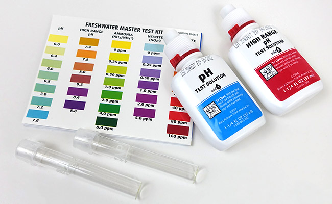 An aquarium test kit, test tubes and testing solution for aquariums