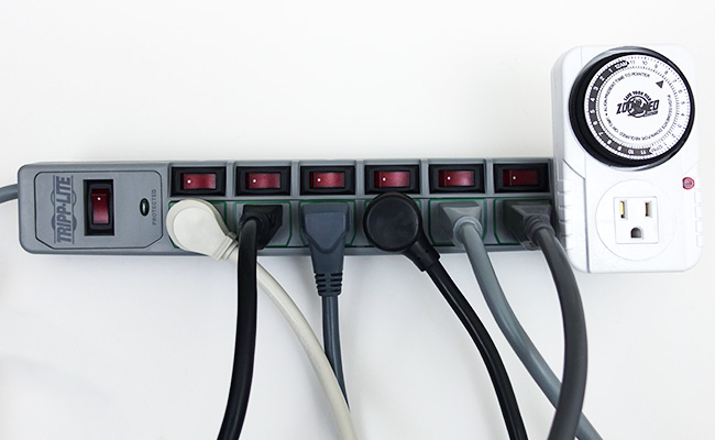 Tripp Lite power strip with electrical aquarium equipment plugged in