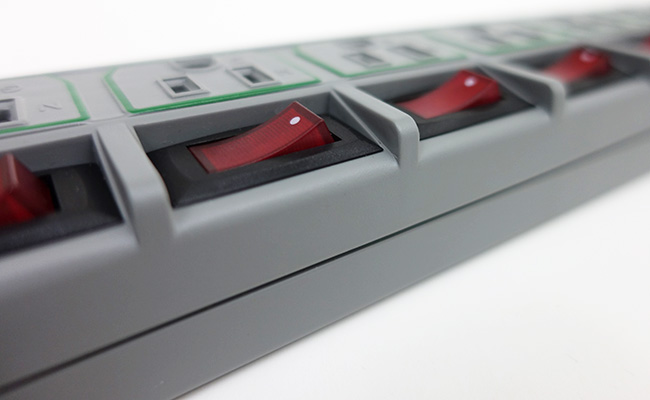 Close up on individually recessed switches on Tripp Lite power strip
