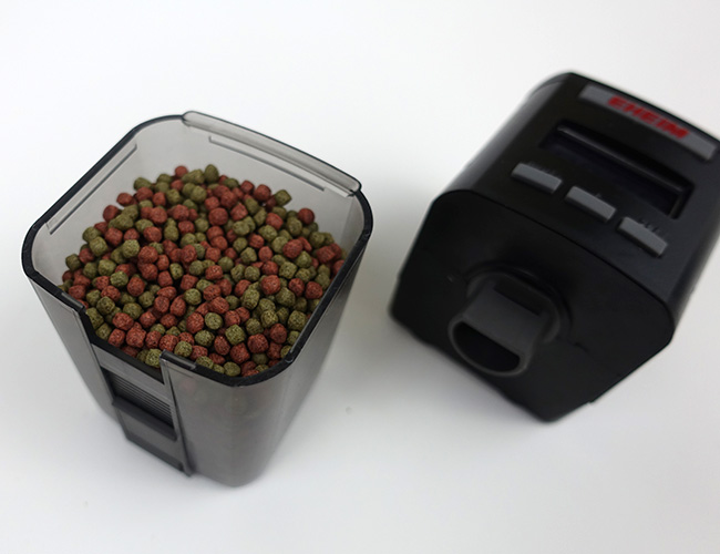 Eheim Everyday Fish Feeder container filled with small pellet food