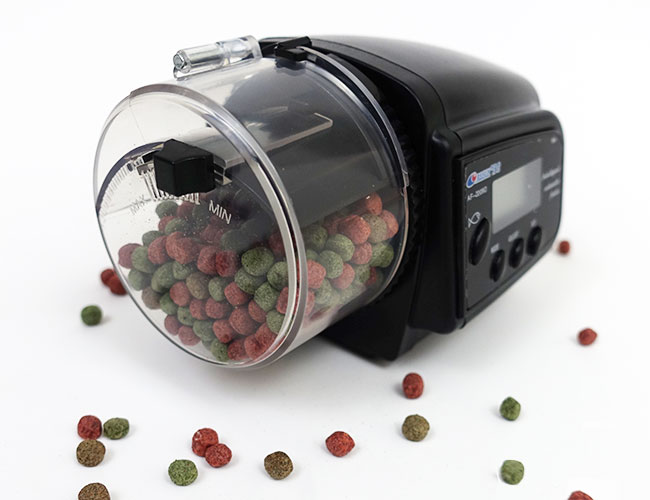 Automatic fish food feeder filled with fish food pellets