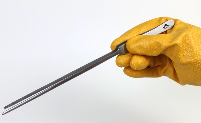 Holding long aquascaping tweezers with hand protected by Showa 772 aquarium glove