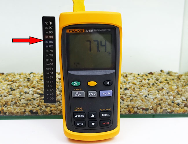 Inaccurate adhesive thermometer strip on aquarium compared to calibrated Fluke thermometer probe