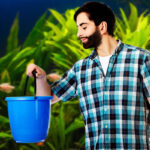 Man holding bucket in front of aquarium