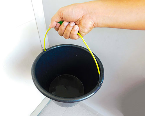 Rinsing out brand new bucket to be used in aquarium