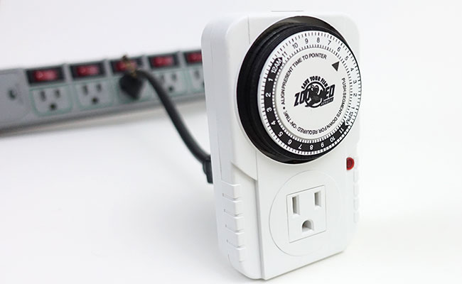 Zoo Med AquaSun aquarium timer plugged into extension cord plugged into power strip