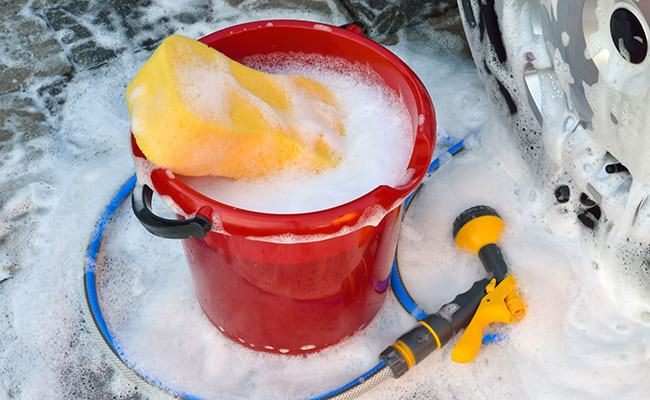 Bucket filled with soapy water to wash car