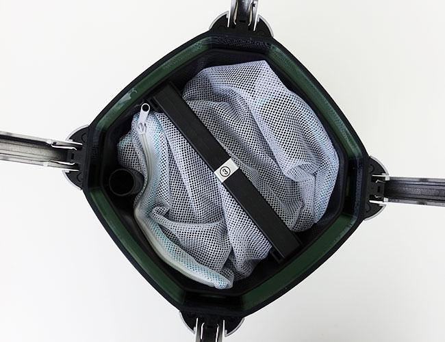 Inserting full media bag into canister filter