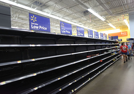 Walmart shelves stripped bare as people stock up on supplies after news of incoming hurricane