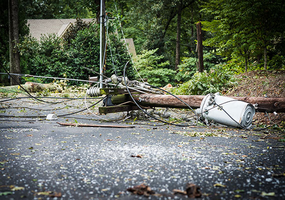 Downed power lines on street resulting in power outage