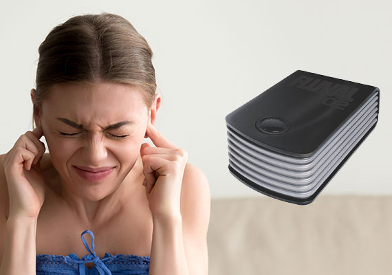 Woman with fingers in her ears trying to block sound from loud air pump